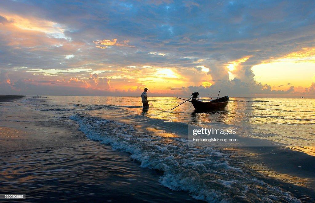 fisherman and his boat : Foto de stock