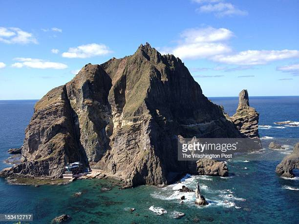A fisherman and his wife live at the base of the taller of Dokdo's main two islands in South Korea on October 4 2012