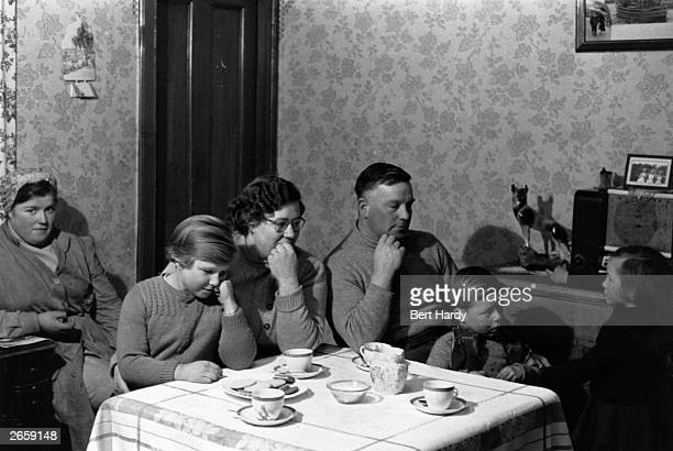 Fisherman and lifeboat coxswain Henry Smith and his family listen in to Reverend Colin Day, the 'Singing Minister of Arbroath', on the wireless....