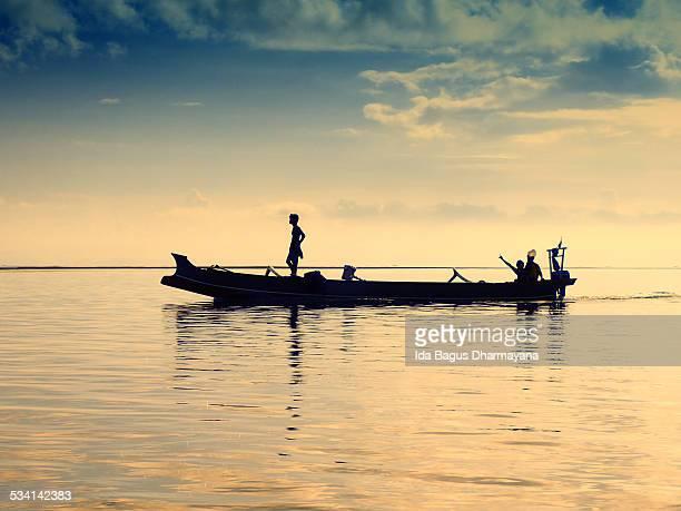 Fisherman And Morning Sun