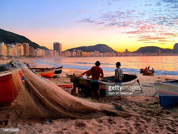 fisherman and nets - copacabana rio de janeiro stock-fotos und bilder