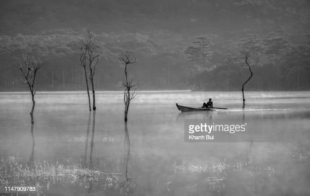 fisherman and trees grow were reflected on the lake - black and white instant print stock pictures, royalty-free photos & images