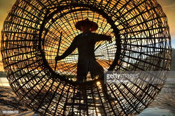 fisherman are using the fisherman's tools in earnest - myanmar stock pictures, royalty-free photos & images