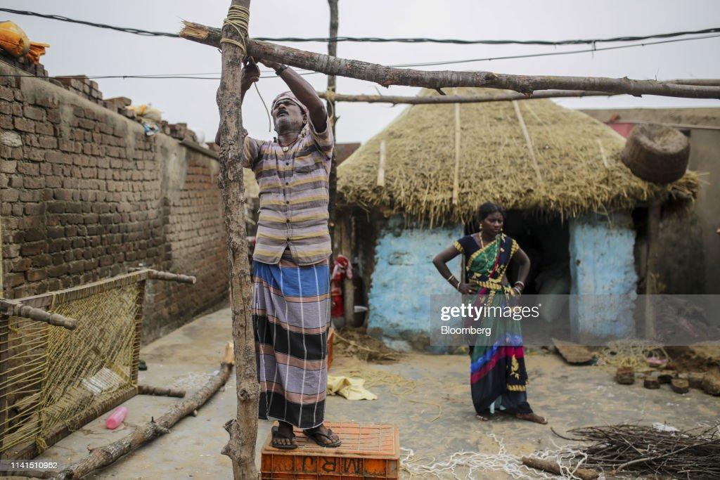 A fisherman arranges wood at a damaged house in Konark, Odisha