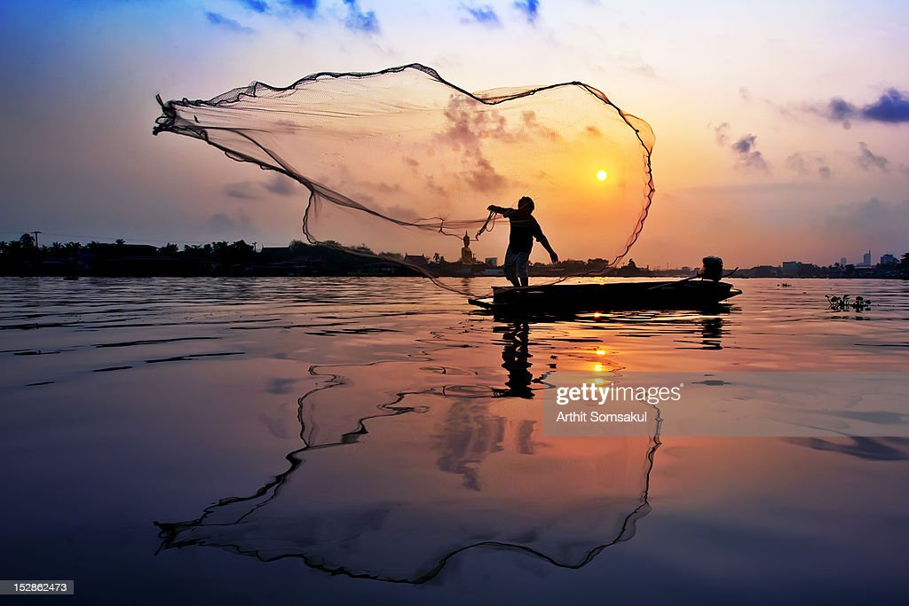 Fisherman at Chaophaya river : Stock Photo