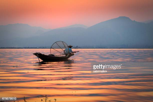 fisherman at inle lake, myanmar - myanmar culture stock photos and pictures