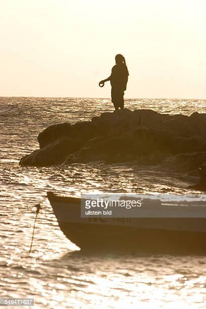 fisherman at Kontiki Beach