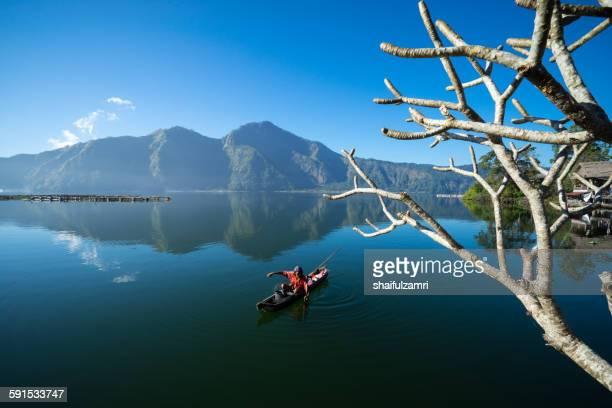 fisherman at lake batur - shaifulzamri stock pictures, royalty-free photos & images