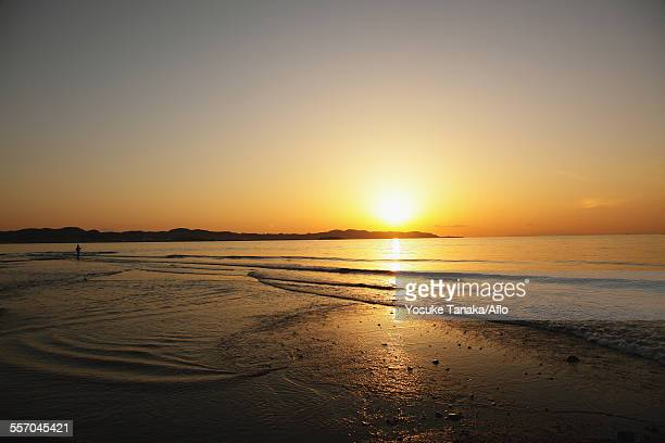 fisherman at sea at sunset, chiba prefecture, japan - chiba city stock pictures, royalty-free photos & images