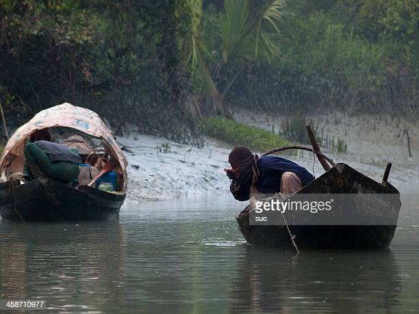 fisherman at sundarban forest - bangladesh nature stock photos and pictures