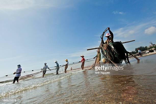 CONTENT] Fisherman at their work on the seacoast of South China Sea Thanh Hoa Vietnam Indochina South East Asia Asia