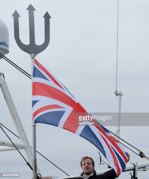 A fisherman attaches a Union Flag to his vessel as fishing boats gather on the River Tyne in North Shields as fishermen take part in a nationwide...