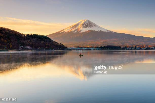 Fisherman boat and Fuji-san in the morning at Kawaguchiko Lake