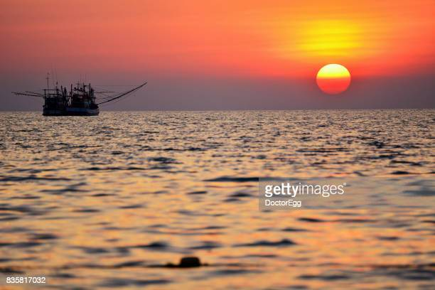 Fisherman Boat with Sunset at Samed Island