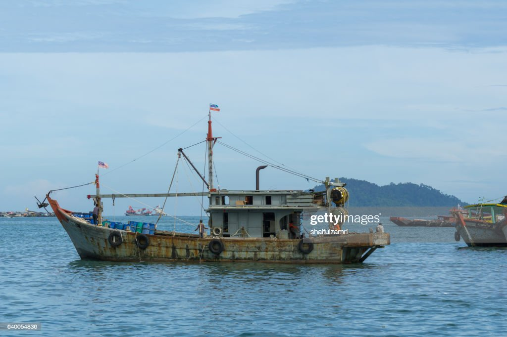 Fisherman boats anchored at Kota Kinabalu jetty : Stock Photo