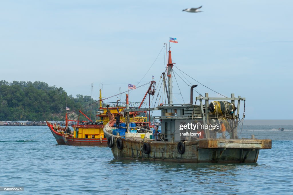 Fisherman boats anchored at Kota Kinabalu jetty : Stock Photo