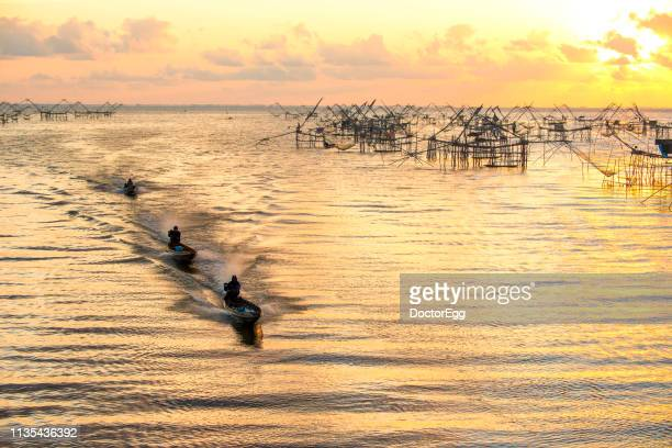 Fisherman Boats and Big Nets at Pak Pra Fisherman Village, Phatthaung Province, Southern of Thailand