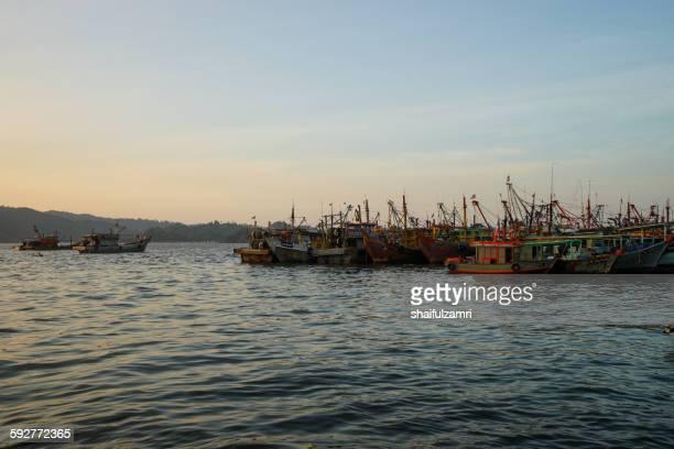 fisherman boats in kota kinabalu - shaifulzamri stock pictures, royalty-free photos & images