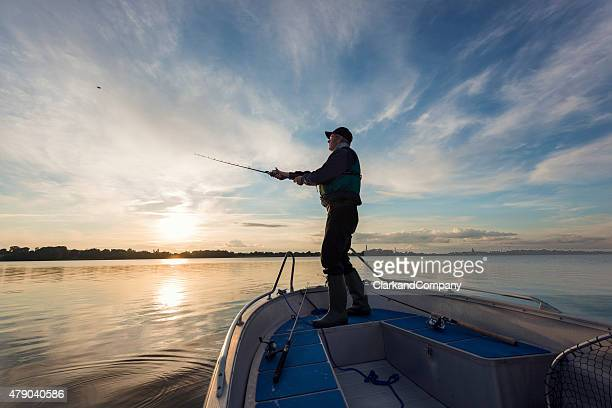 fisherman casting out his line - nautical vessel stock pictures, royalty-free photos & images