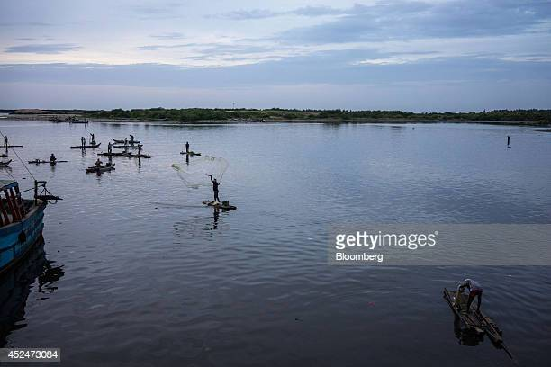 A fisherman casts his net in Puducherry India on Saturday July 19 2014 Indias gross domestic product growth forecast for the year ending March was...