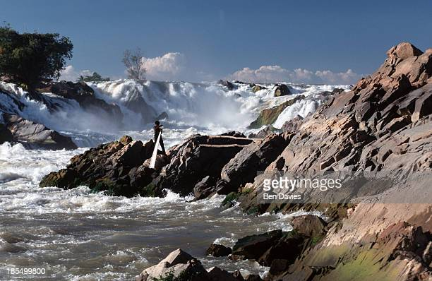 A fisherman casts his net into the raging Khone Phapheng falls in Champassak Province in Southern Laos So impassable were these rapids that during...