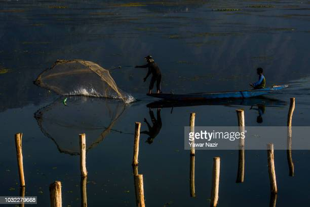 A fisherman casts his net on the waters of Dal lake on September 12 2018 in Srinagar the summer capital of Indian administered Kashmir India Kashmir...