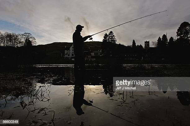 Fisherman casts his rod across the River Tay on the opening day of the salmon season at Kenmore on January 16, 2006 in Kenmore, Scotland. The season...