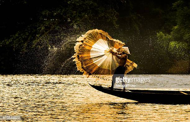 Fisherman catch fish in the river in Hue, Vietnam.