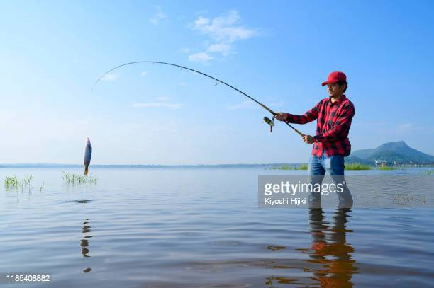 fisherman caught fish for his fishing in weekend - catching stock pictures, royalty-free photos & images
