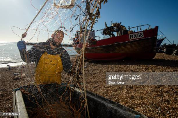 A fisherman clears his nets after a fishing trip in Hastings UK on Wednesday Nov 4 2020 In a sign that an agreement could be struck by the...