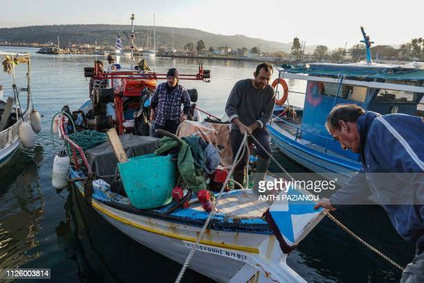 Fisherman Costas Karamanolis arrives at the harbour in Panagiouda in the island of Lesbos on January 19 2019 Every afternoon Karamanolis a fisherman...
