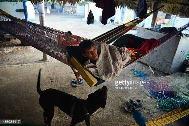 Fisherman Cruz Torres Castillo friend of Salvadorean castaway Jose Salvador Alvarenga rests before going out to work on February 5 2014 in the town...