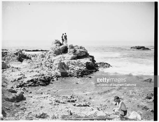 Fisherman drownsPalos Verdes 6 October 1951 Albert Hart beside body of unidentified fisherman who was swept off rocks and drowned while fishing...