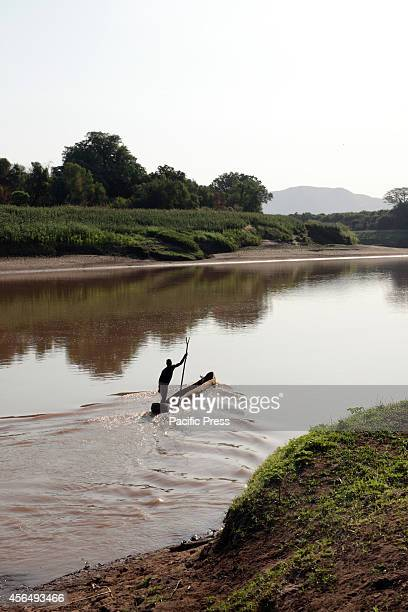 A fisherman fishing in Omo River where the Gibe III is located Gibe III Dam Africas Tallest Dam with installed capacity of 1870 MW which is under...