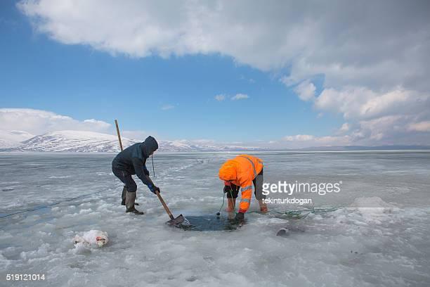 fisherman fishing on the frozen Cildir lake at kars turkey
