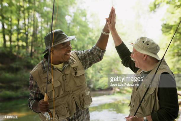 Fisherman high fiving