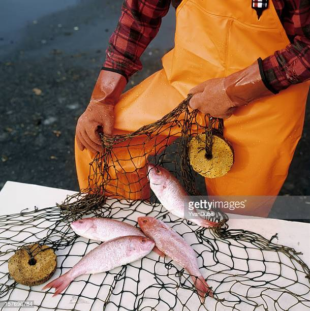 fisherman holding a fishing net