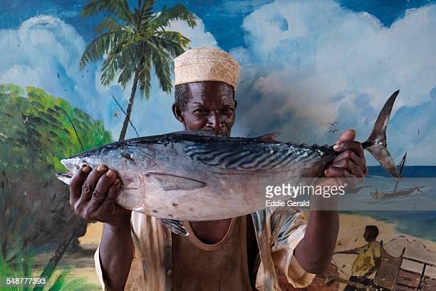 A fisherman holding a fresh Tuna fish in Zanzibar island Tanzania Africa