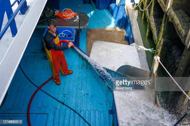 A fisherman hoses the deck of his boat in the harbour in Scarborough UK on Tuesday June 2 2020 The threat of a nodeal Brexit is back and with it the...