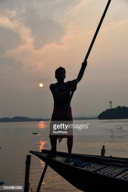 Fisherman in a boat in the bank of Brahmaputra river in Guwahati, Assam, India on Tuesday, 2 October 2018.