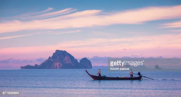 Fisherman in Ao Nang beach during sunrise ( Krabi , Thailand , Asia )