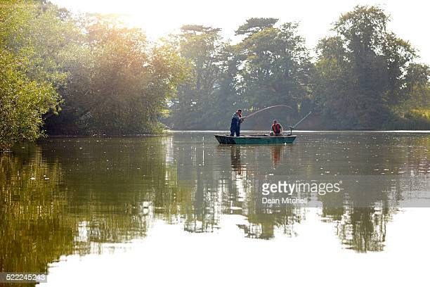 Fisherman in bass boat enjoying fly fishing