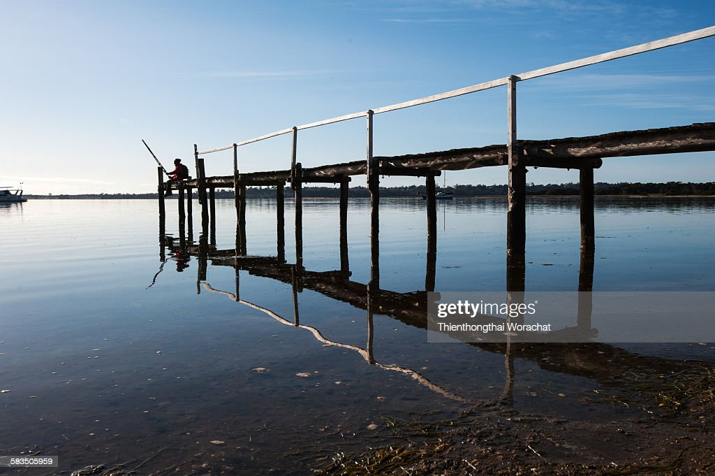 A fisherman in Bay of fires : Stock Photo