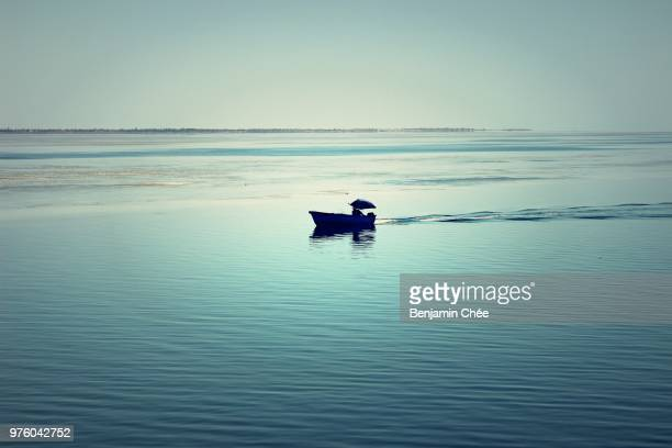 fisherman in boat on sea, djerba, tunisia - djerba stock pictures, royalty-free photos & images
