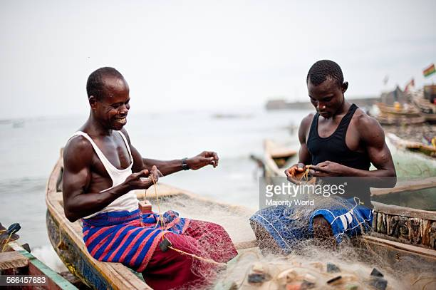 Fisherman in boats with fishing nets Jamestown Accra Ghana