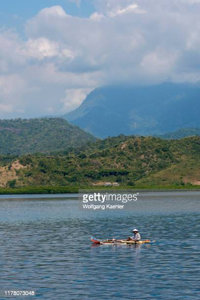 Fisherman in his outrigger boat at Bungin Island, off the coast of Sumbawa Island, Indonesia, home to a group of Bajau Sea Gypsies, famous for living...