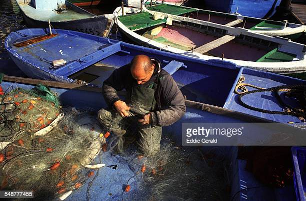 A fisherman in old Jaffa port Israel
