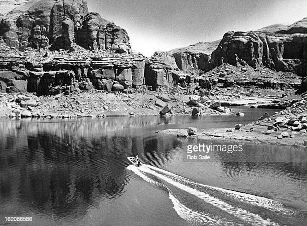 APR 21 1978 Fisherman In Small Boat Disturbs Tranquil Waters Of Lake Powell The fisherman searching for fhe rocky brushy coves hiding largemouth bass...