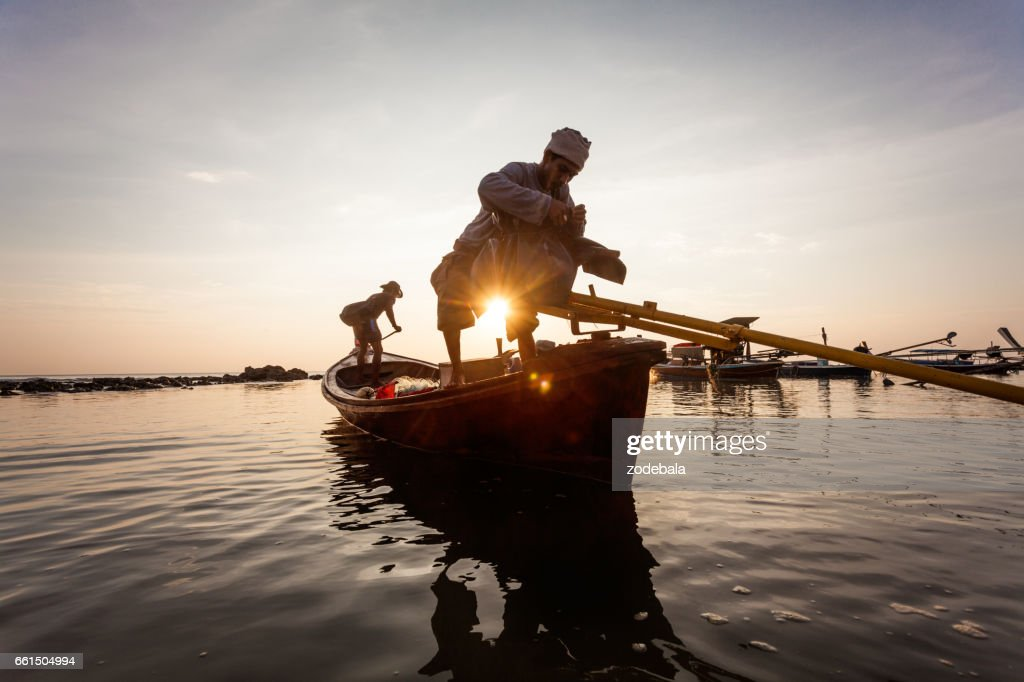 Fisherman in Thailand at Sunset : Stock Photo