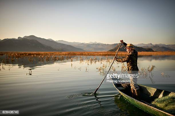 fisherman in the boat - montenegro stock pictures, royalty-free photos & images